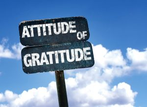 Attitude of Gratitude sign with sky background